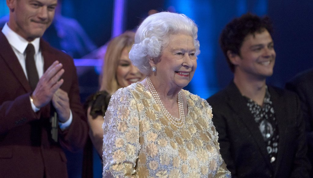 Queen Elizabeth II smiles on stage at the Royal Albert Hall in London on Saturday April 21, 2018, for a concert to celebrate her 92nd birthday. (David Mirzoeff/Pool via AP)