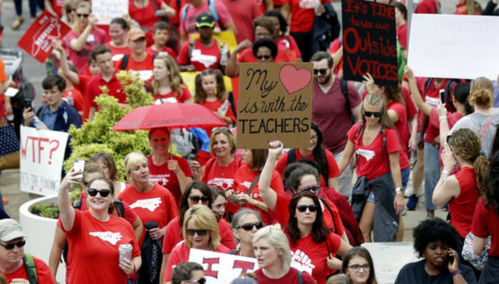 Protesting teachers march toward the Legislative Building during a rally at the General Assembly in Raleigh, N.C., Wednesday, May 16, 2018. (AP/Gerry Broome)