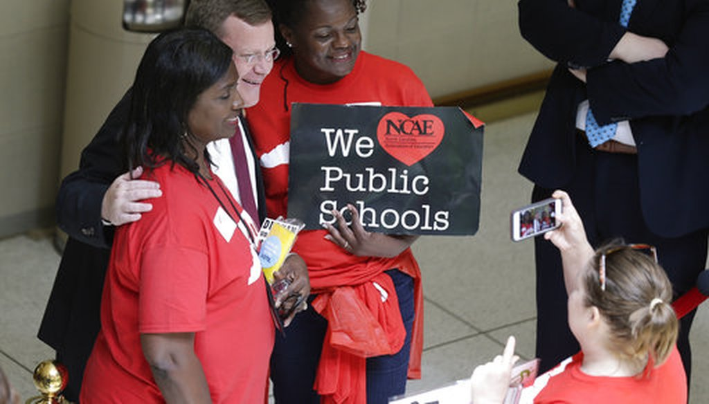 House speaker Tim Moore poses for a a photo with educators during a teachers rally at the General Assembly in Raleigh, N.C., Wednesday, May 16, 2018. (AP/Gerry Broome)