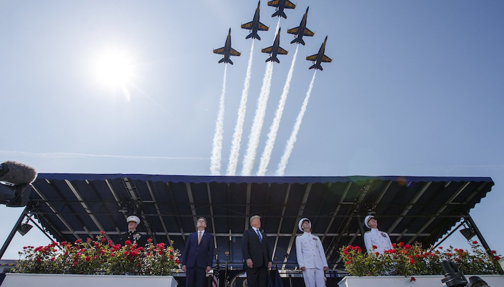 President Donald Trump looks on as the Blue Angels fly over the graduation ceremony at the U.S. Naval Academy on May 25, 2018, in Annapolis, Md. (AP)