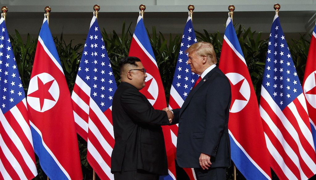 North Korean leader Kim Jong Un and U.S. President Donald Trump shake hands prior to their meeting on Sentosa Island in Singapore on June 12, 2018. (AP)