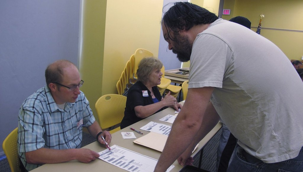 A North Dakota resident receives voting instructions at the downtown Fargo public library on June 12, 2018 in Fargo, N.D.