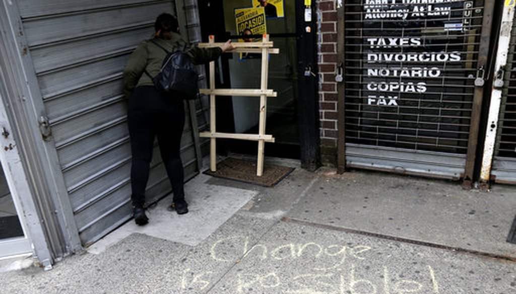 A message is written in chalk on the sidewalk outside campaign offices of Alexandria Ocasio-Cortez in the Queens borough of New York, Wednesday, June 27, 2018.
