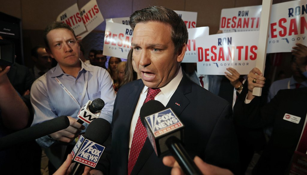 U.S. Rep. Ron DeSantis answers questions from reporters after a Florida Republican gubernatorial primary debate at the Republican Sunshine Summit Thursday, June 28, 2018, in Kissimmee, Fla. (AP Photo/John Raoux)