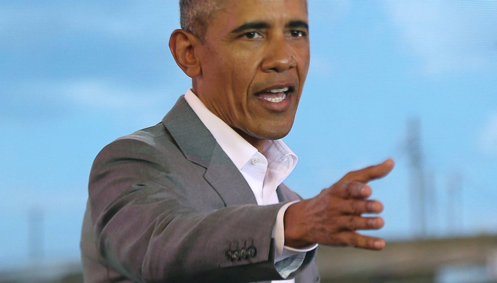 Former U.S. President Barack Obama gestures to the crowd during an event in Kogelo, Kisumu, Kenya, on July 16, 2018. Obama was in Kenya to launch a sports and training center founded by his half-sister, Auma Obama. (AP)