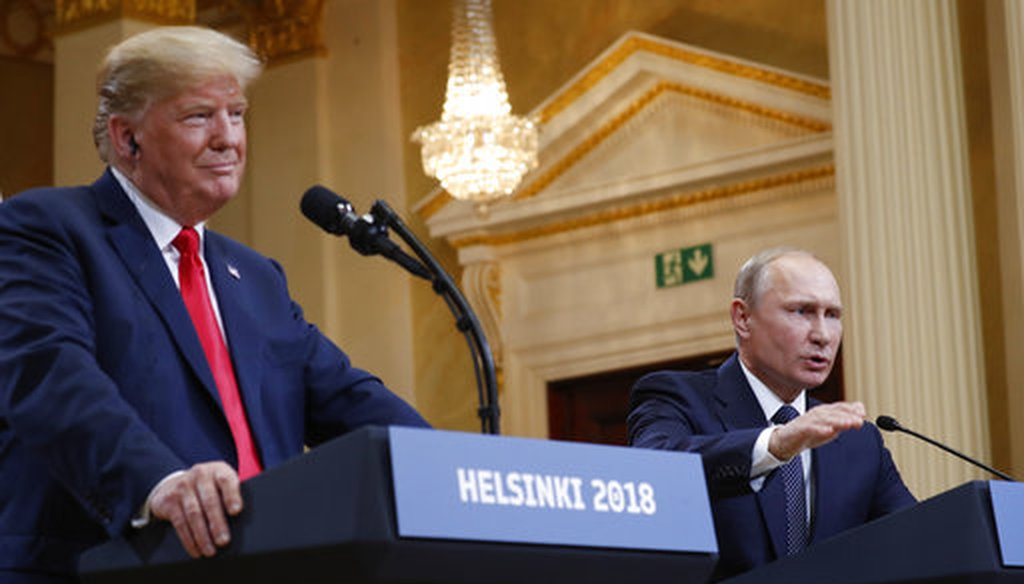 Russian President Vladimir Putin gestures while speaking as President Donald Trump looks on during their joint news conference in Helsinki on July 16, 2018. (AP/Pablo Martinez Monsivais)