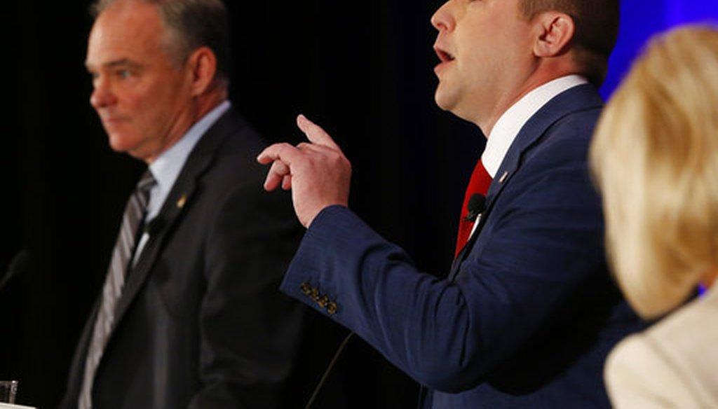 Sen. Tim Kaine listens as Republican Corey Stewart gestures during the Virginia Bar Association debate in Hot Springs, Va., on July 21, 2018 (AP/Steve Helber)