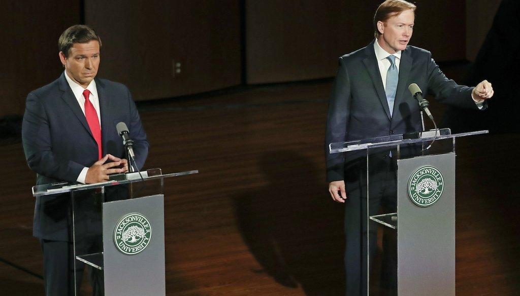Republican gubernatorial candidates Ron DeSantis, left, and Adam Putnam debate Aug. 8, 2018, in Jacksonville, Fla. (AP Photo/John Raoux)