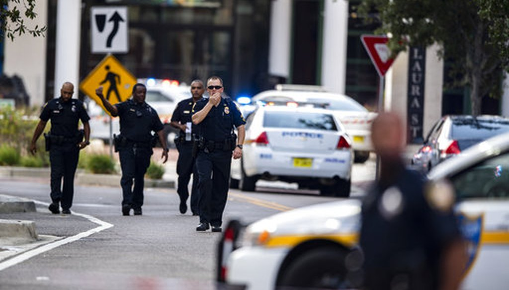 Police seen after a shooting at the Jacksonville Landing in Jacksonville, Aug. 26, 2018. (AP Photo/Laura Heald)