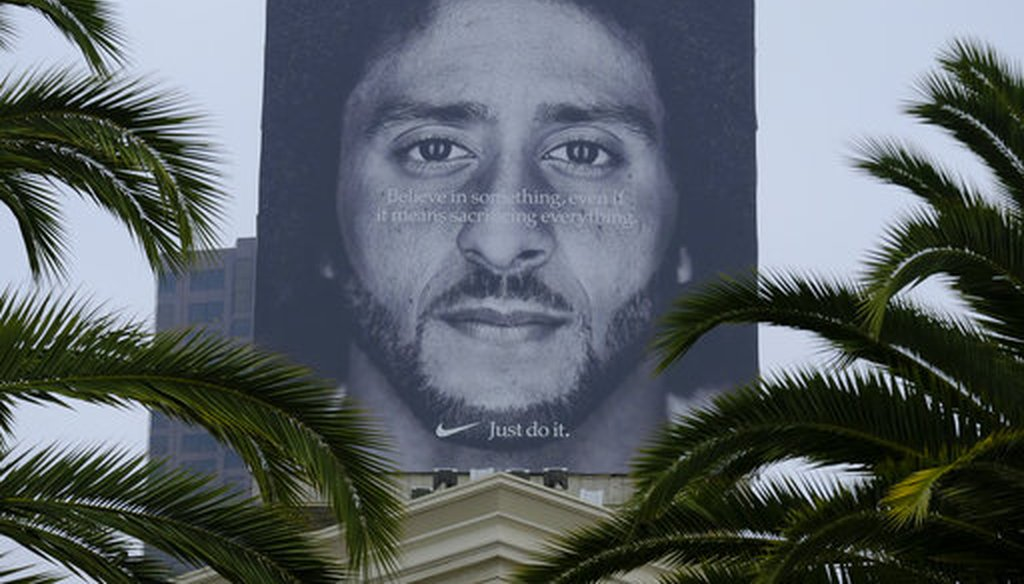 A billboard stands on top of a Nike store showing former San Francisco 49ers quarterback Colin Kaepernick on Sept. 5, 2018, in San Francisco. (AP/Eric Risberg)