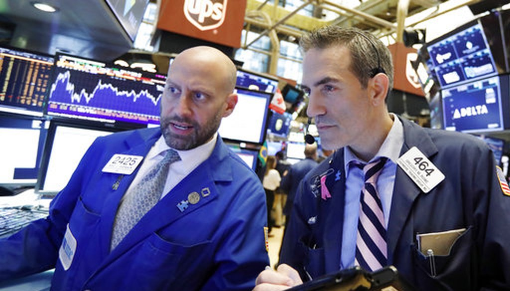 Specialist Meric Greenbaum, left, and trader Gregory Rowe work on the floor of the New York Stock Exchange on Sept. 14, 2018. (AP/Richard Drew)