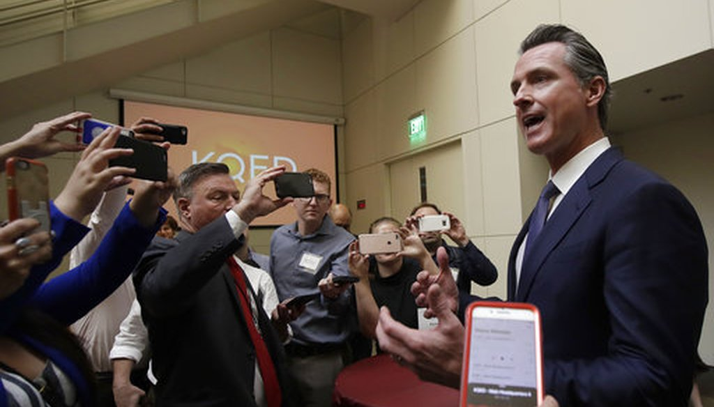 Democratic candidate Gavin Newsom, right, speaks with reporters after a California gubernatorial debate with Republican candidate John Cox at KQED Public Radio Studio in San Francisco on Oct. 8, 2018. (AP/Jeff Chiu, Pool)