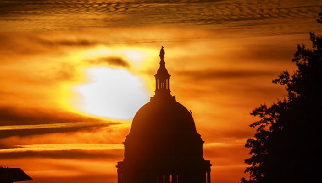 The rising sun silhouettes the U.S. Capitol dome at daybreak on Oct. 26, 2018. (AP/Alex Brandon)