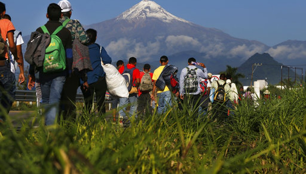 Central American migrants begin their morning trek as part of a thousands-strong caravan hoping to reach the U.S. border, as they face the Pico de Orizaba volcano upon departure from Cordoba, Veracruz state, Mexico, Nov. 5, 2018. (AP Photo/Marco Ugarte)