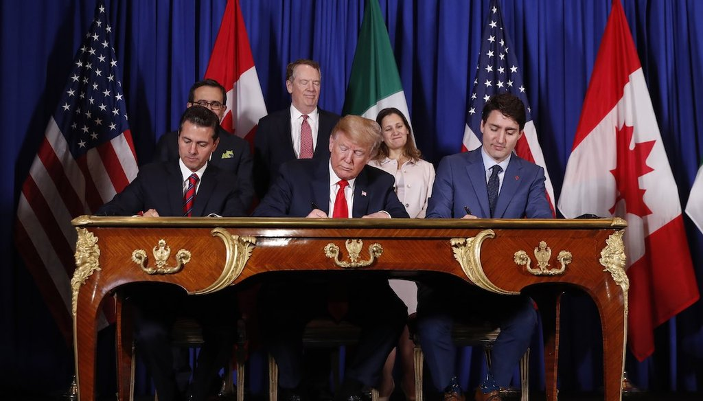 President Donald Trump, Canada's Prime Minister Justin Trudeau and Mexico's President Enrique Pena Nieto, participate in the USMCA signing ceremony at G20 in Buenos Aires, Argentina on Nov. 30, 2018.