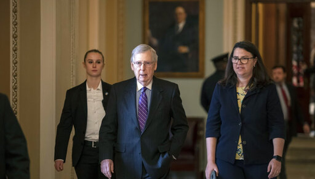 Senate Majority Leader Mitch McConnell, R-Ky., and Secretary for the Majority Laura Dove, right, in the U.S. Capitol on Jan. 23, 2019. (AP)