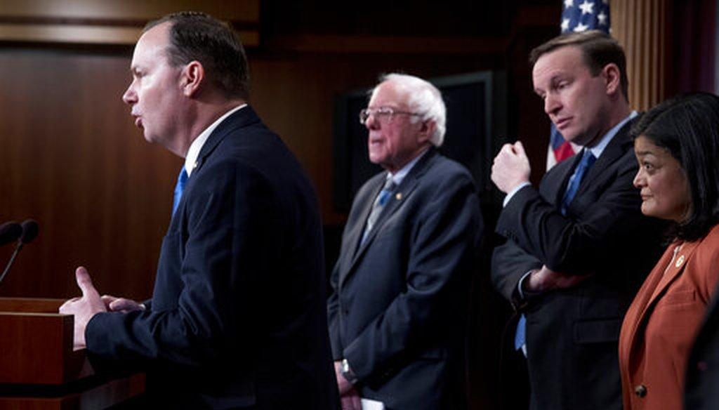 Sen. Mike Lee, R-Utah, joins Sen. Bernie Sanders, I-Vt., Sen. Chris Murphy, D-Conn., and Rep. Pramila Jayapal, D-Wash., on Jan. 30, 2019, to reintroduce a resolution to end U.S. support for the Saudi-led war in Yemen. (AP)