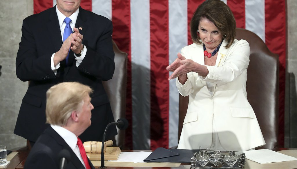 President Donald Trump turns to House Speaker Nancy Pelosi of Calif., as he delivers his State of the Union address, while Vice President Mike Pence watches, Feb. 5, 2019. (AP)