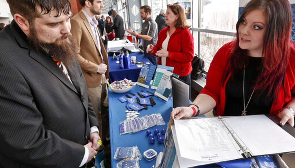 Visitors to a Pittsburgh veterans job fair meet with recruiters at Heinz Field on March 7, 2019. (AP)