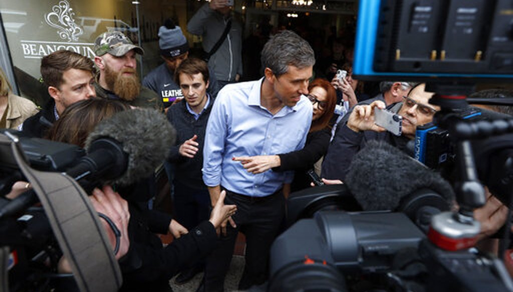 Former Texas congressman Beto O'Rourke speaks to reporters after a meet and greet at the Beancounter Coffeehouse & Drinkery, Thursday, March 14, 2019, in Burlington, Iowa. (AP Photo/Charlie Neibergall)