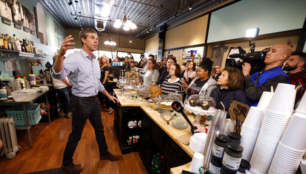 Former Texas congressman Beto O'Rourke speaks to local residents during a meet and greet at the Beancounter Coffeehouse & Drinkery, March 14, 2019, Burlington, Iowa. (AP Photo/Charlie Neibergall)