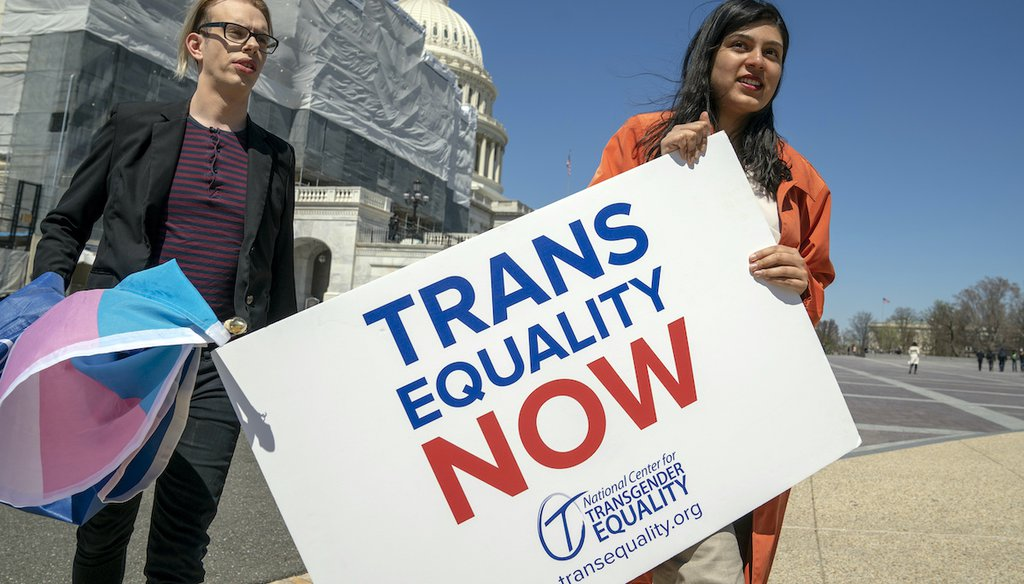 Ketaki Deo, right, and Charlie Whittington, students at George Washington University, arrive for an event supporting The Equality Act, a comprehensive nondiscrimination bill for LGBT rights, on Capitol Hill in Washington on April 1, 2019. (AP)