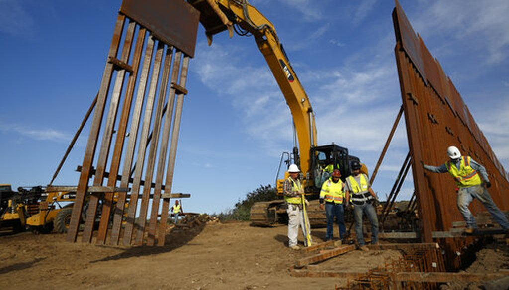 In this Jan. 9, 2019 file photo, construction crews install new border wall sections seen from Tijuana, Mexico. The government is working on replacing and adding fencing in various locations. (AP)