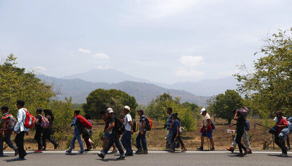 Central American migrants traveling in a caravan to the U.S. walk through Tonala, Chiapas state, Mexico, April 21, 2019. (AP/Moises Castillo)
