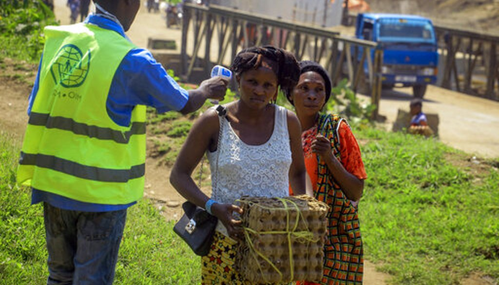 People crossing the border have their temperature taken to check for symptoms of Ebola at the border crossing near Kasindi, eastern Congo on June 12, 2019. (AP)