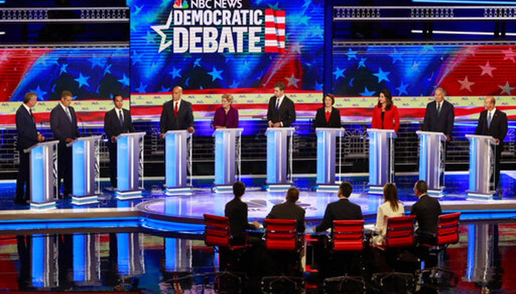 The set of the Democratic primary debate hosted by NBC News on June 27, 2019, in Miami, featured flag imagery and a patriotic color pallet of red, white and blue. (AP Photo/Wilfredo Lee)