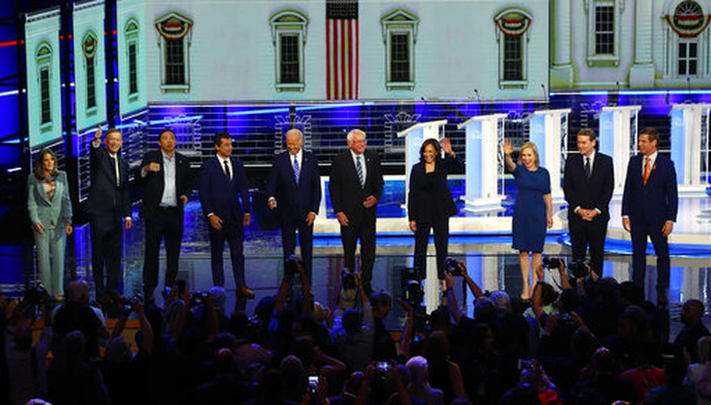 Democratic presidential candidates wave as they enter the stage for the second night of the Democratic primary debate, Thursday, June 27, 2019, in Miami (AP).