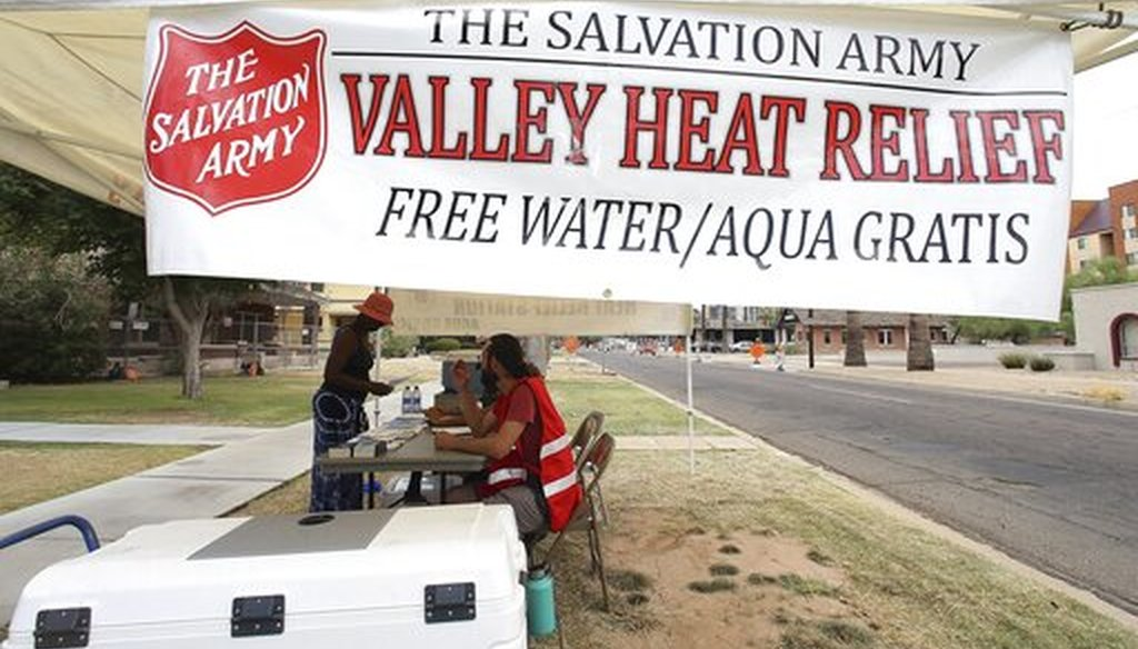Salvation Army volunteers keep a hydration stations open as temperatures are expected to hit 113-degrees July 11, 2019, in Phoenix. (AP)