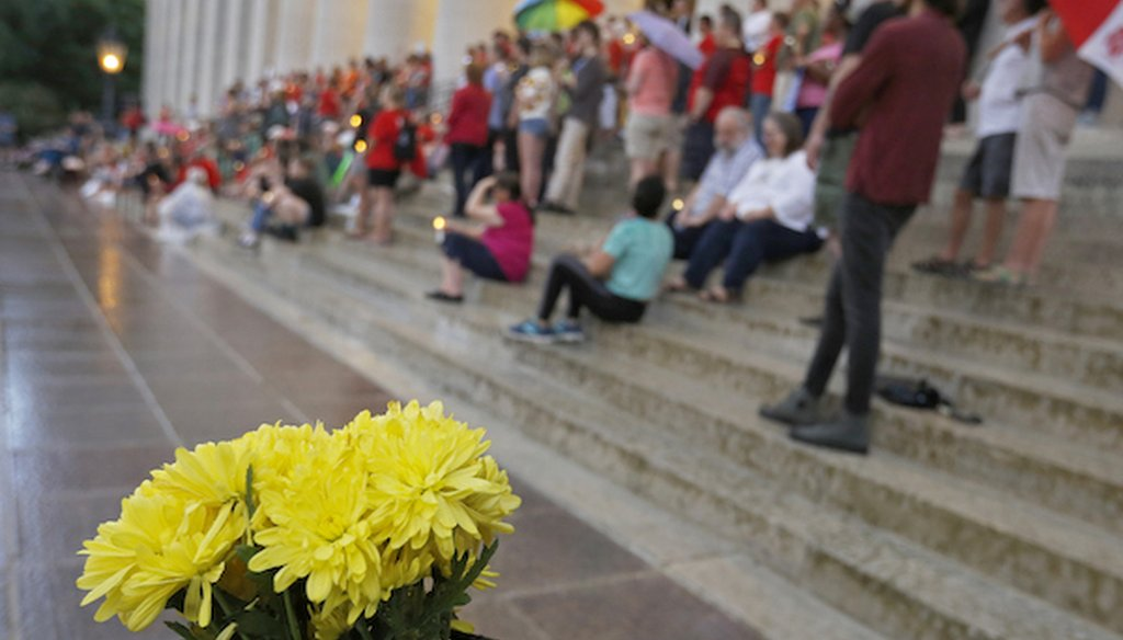 People attend a candlelight vigil at the Ohio Statehouse in Columbus after mass shootings in Ohio and Texas. (AP)