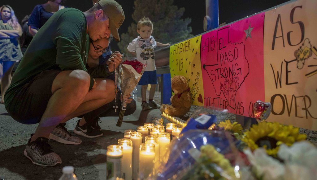 People gather in Juarez, Mexico, Saturday, Aug. 3, 2019, in a vigil for the three Mexican nationals who were killed in an El Paso shopping-complex shooting. (AP Photo/Andres Leighton)