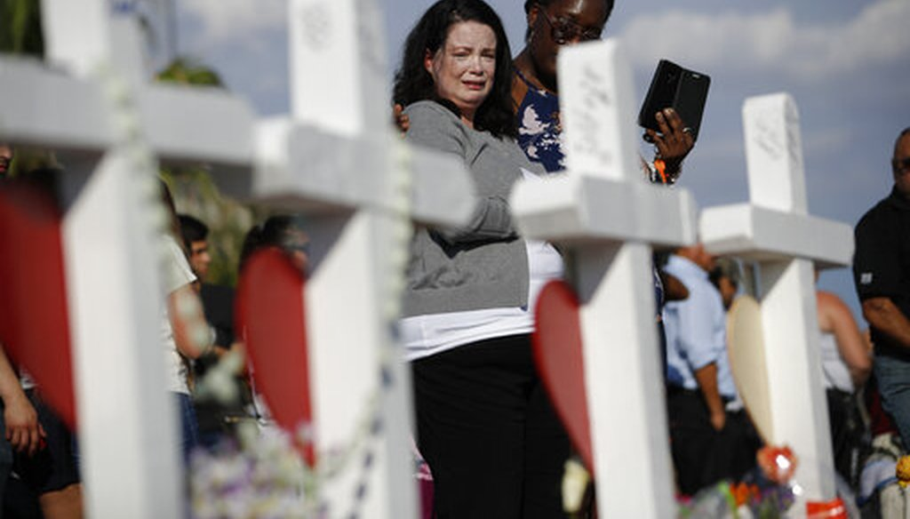 Christina Pipkin cries as she visits a makeshift memorial at the site of a mass shooting in El Paso, Texas, on Aug. 5, 2019. (AP)
