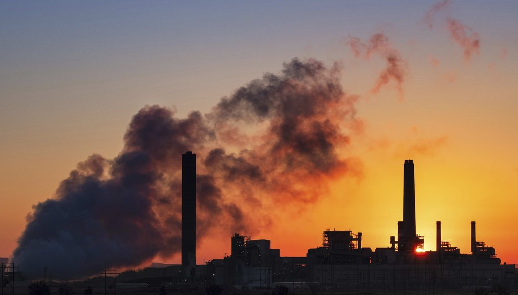 In this July 27, 2018, file photo, the Dave Johnson coal-fired power plant is silhouetted against the morning sun in Glenrock, Wyo. (AP)