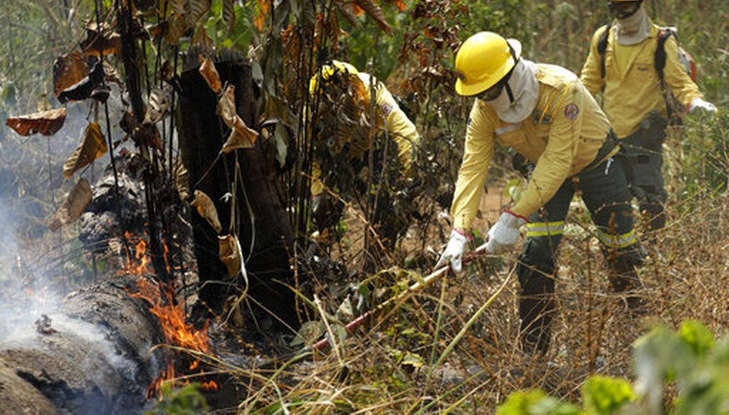Firefighters work to put out forest fires in the Vila Nova Samuel region, part of Brazil's Amazon, Aug. 25, 2019. (AP Photo)