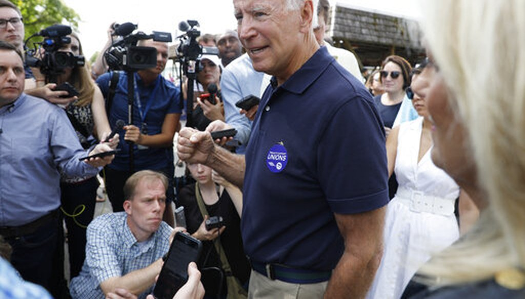 Democratic presidential candidate former Vice President Joe Biden speaks to reporters during the Hawkeye Area Labor Council Labor Day Picnic, Sept. 2, 2019, in Cedar Rapids, Iowa. (AP/Charlie Neibergall)