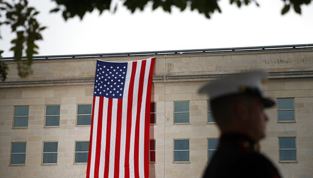 A flag hangs on the Pentagon before a ceremony in observance of the 18th anniversary of the September 11th attacks at the Pentagon in Washington, Sept. 11, 2019. (AP/Patrick Semansky)