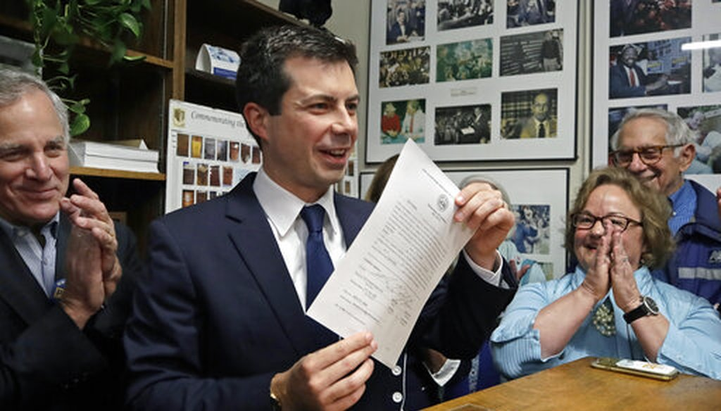 Democratic presidential candidate South Bend, Ind., Mayor Pete Buttigieg holds up the paper he signed to be placed on the New Hampshire primary ballot, at the Statehouse, Oct. 30, 2019, in Concord, N.H. (AP/Elise Amendola)