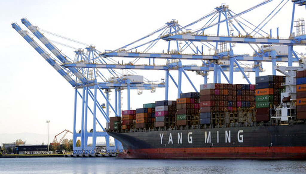 Cargo cranes take containers off of a Yang Ming Marine Transport Corporation boat at the Port of Tacoma in Tacoma, Wash., in 2019. (AP)