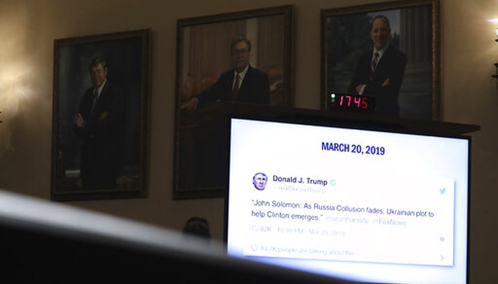 A tweet from President Donald Trump is displayed as former U.S. Ambassador to Ukraine Marie Yovanovitch testifies before the House Intelligence Committee in Washington on Nov. 15, 2019. (AP/Harnik)