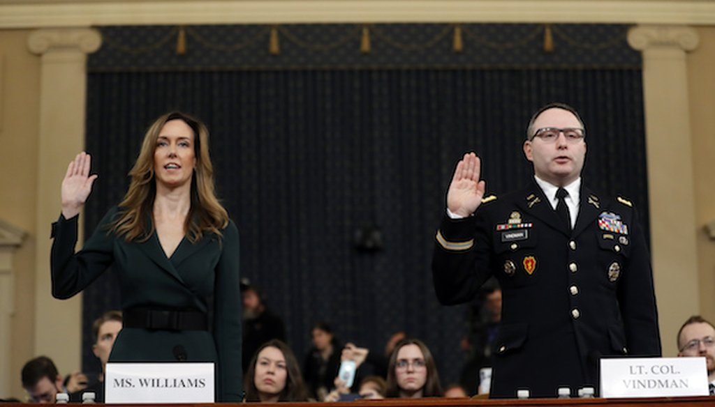 Jennifer Williams, an aide to Vice President Mike Pence, left, and National Security Council aide Lt. Col. Alexander Vindman, are sworn in to testify before the House Intelligence Committee. (AP)