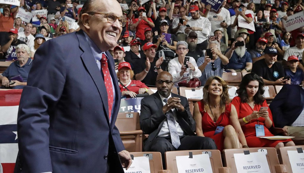 In this Aug. 15, 2019, file photo, former New York City Mayor Rudy Giuliani smiles as he arrives to President Donald Trump's campaign rally in Manchester, N.H. (AP)