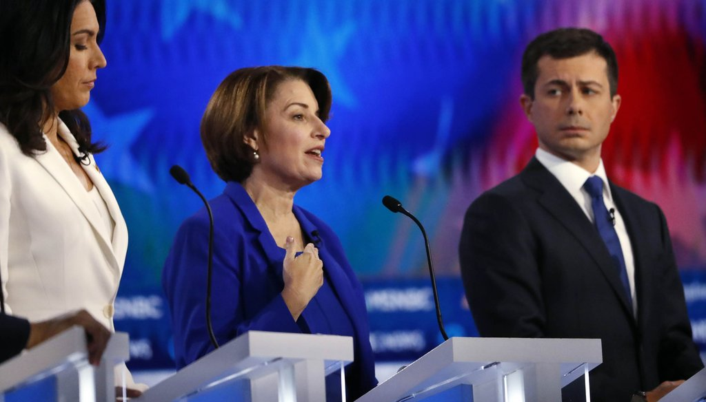 Democratic presidential candidate Sen. Amy Klobuchar, D-Minn., center speaks during a Democratic presidential primary debate, Wednesday, Nov. 20, 2019, in Atlanta. (AP
