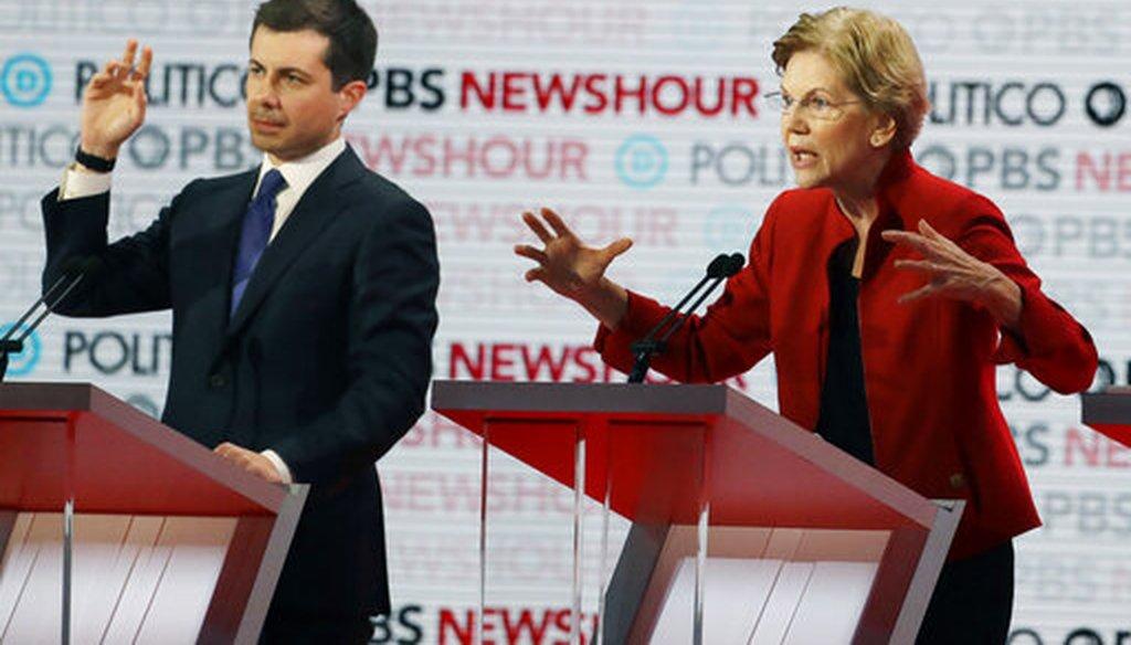 Democratic presidential candidate Sen. Elizabeth Warren, D-Mass., speaks as South Bend Mayor Pete Buttigieg listens during a Democratic presidential primary debate, Dec. 19, 2019, in Los Angeles. (AP/Chris Carlson)