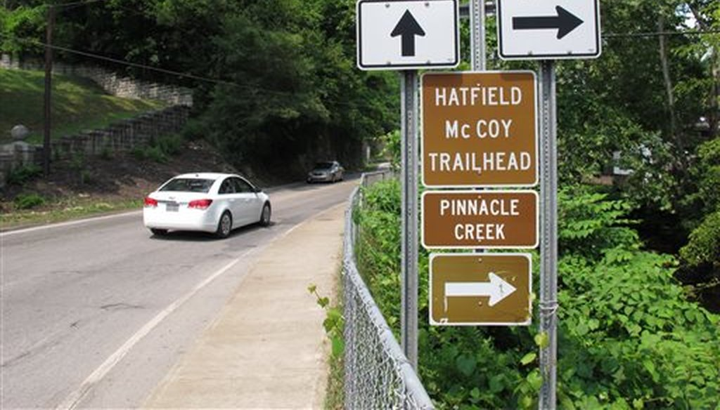 Signs advertise an all-terrain vehicle trail named for a pair of famous Appalachian feuding families in Pineville, W.V.. (AP)