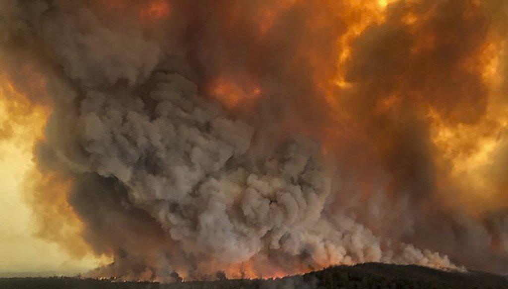 In this Dec. 30, 2019, aerial photo, wildfires rage under plumes of smoke in Bairnsdale, Australia. (AP)