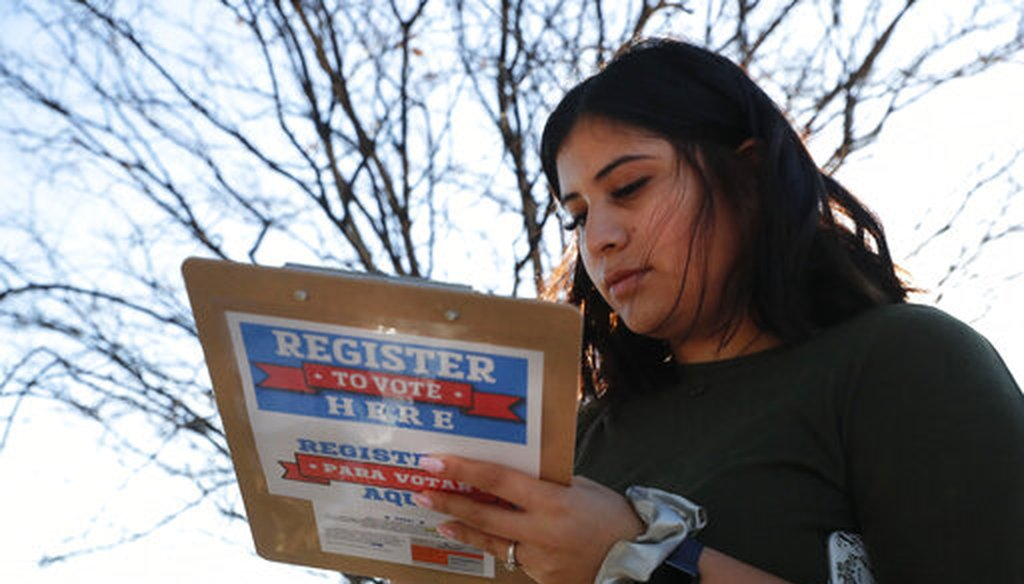 Karina Shumate, 21, a college student studying stenography, fills out a voter registration form in Richardson, Texas, on Jan. 18, 2020.  (AP)