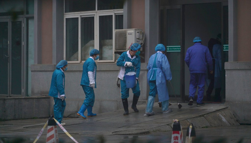 Hospital staff wash the emergency entrance of Wuhan Medical Treatment Center, where some infected with a new virus are being treated, in Wuhan, China, on Jan. 22, 2020. (AP)